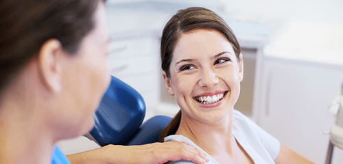 Women smiling at dentist